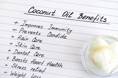 list of coconut oil benefits with jar of coconut oil on the side