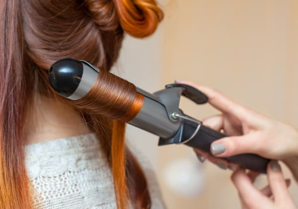 Crcreate curls with curling irons